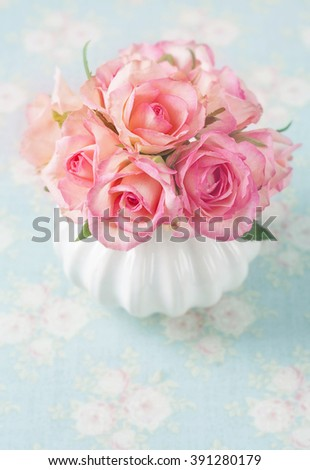 Pink roses in a white vase - stock photo