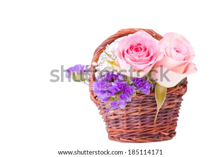 pink roses in brown basket for withe background - stock photo