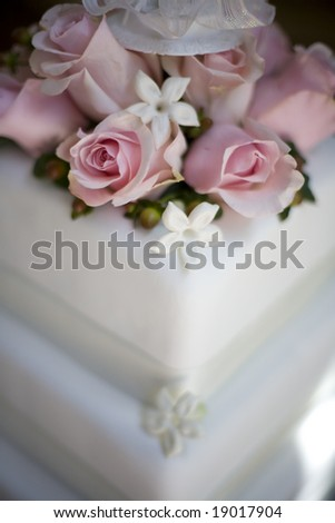 pink roses on a wedding cake - stock photo