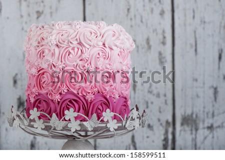 pink rosette  wedding cake - stock photo