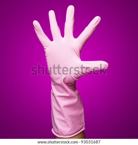 pink rubber gloves against a pink background - stock photo