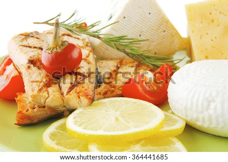 pink salmon and french cheeses on green - stock photo