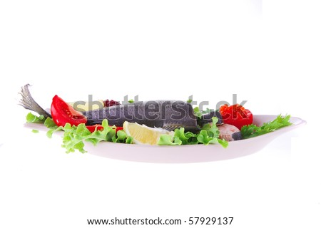 pink salmon and vegetables served on plate - stock photo