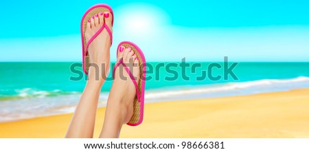 Pink sandals on woman legs. Summer time concept - stock photo
