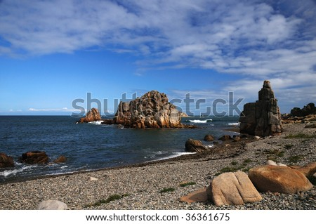Pink sandstone rocks in french Brittany - stock photo