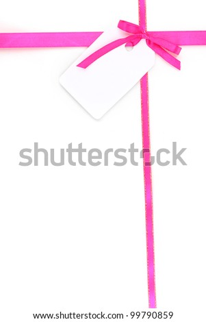 Pink satin bow and ribbon with blank gift tag isolated on white