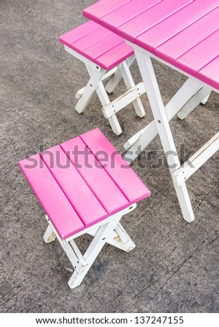 Pink Seats and Table - Street Bar - stock photo