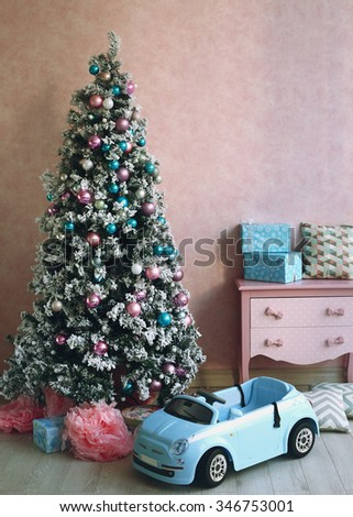 pink shabby chick retro room interior with christmas tree decoration - stock photo