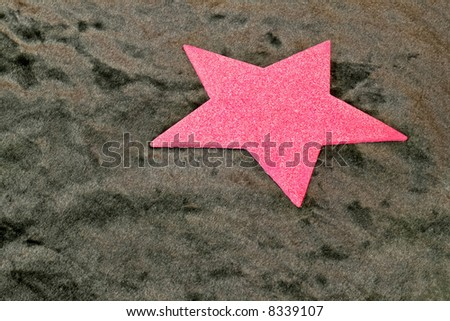 Pink shiny star shape with black background
