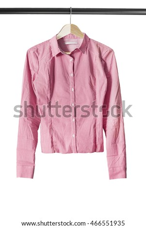 Pink shirt on wooden clothes rack isolated over white