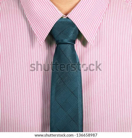 pink shirt with dark blue necktie