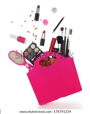 Pink shopping bag with various cosmetics isolated on white  - stock photo