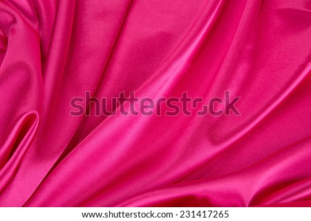 Pink silk background. Close up. Whole background. - stock photo