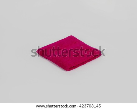 Pink single bathroom towel on gray background