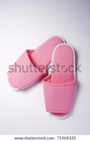 Pink slippers isolated on the white background. - stock photo