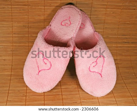 Pink slippers with a heart sign - stock photo