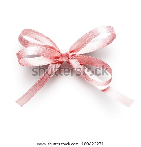 Pink small ribbon bow isolated on white background, clipping path included - stock photo