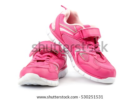 Pink sneakers isolated on a white background.