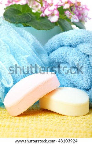 Pink soap, towel, stone and flowers