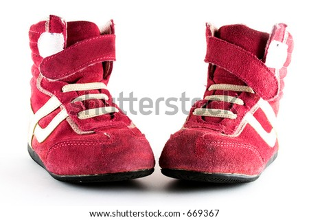 Pink sport shoes over a white bright background. - stock photo