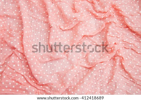 Pink spotted textile can use as background - stock photo