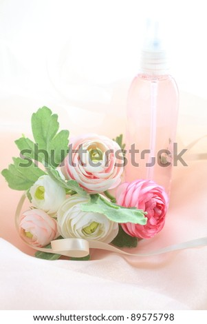 Pink spray bottle and artificial flower for perfume and cosmetic image