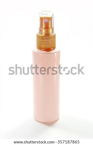 Pink Sprayer Bottle with Cap for cosmetic, perfume, deodorant, freshener. - stock photo