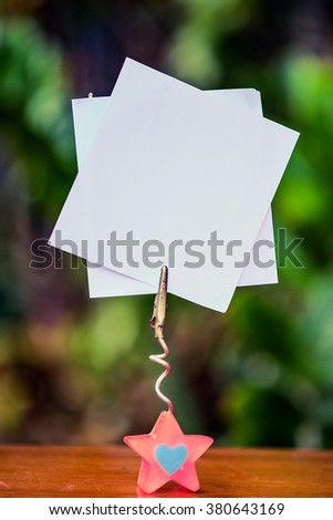 pink star glass note-holder with alligator clip and blank white note  - stock photo