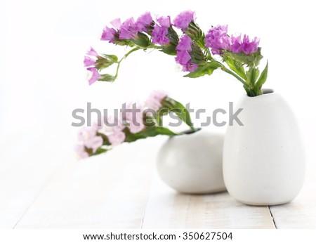 Pink statice flower white vase on stock photo royalty free pink statice flower in white vase on wooden white background pink limonium sinuatum statice salem mightylinksfo