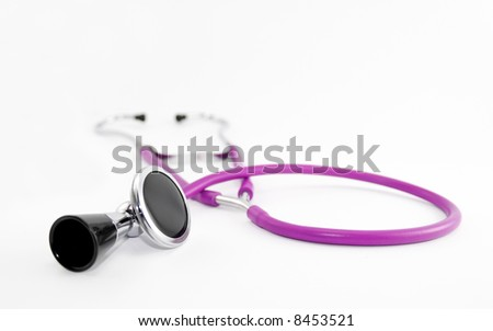Pink stethoscope isolated on white