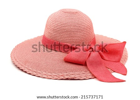 Pink straw hat with bow isolated on white - stock photo