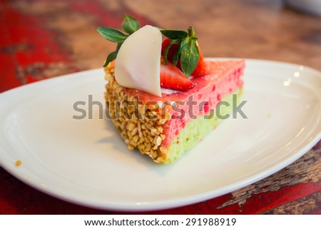 Pink strawberry cheese cake on white dish