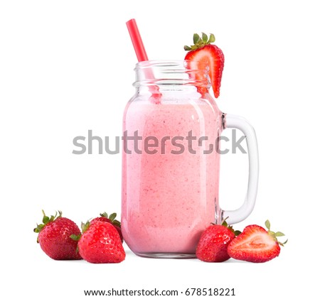 Pink strawberry drink, isolated on a white background. Strawberry milk in a transparent glass with bright red straw. Summer, refreshing cocktail from milk, berries and some strawberries around.