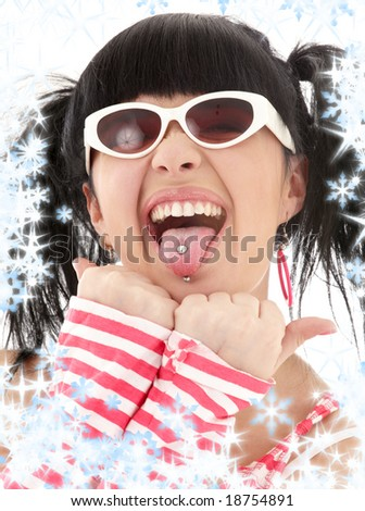 pink striped Asian girl portrait with snowflakes - stock photo