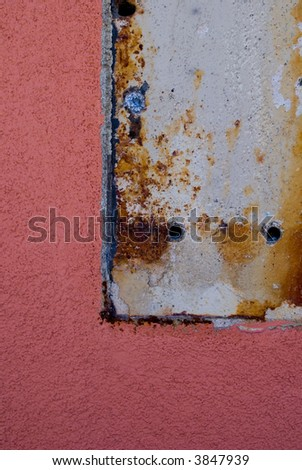 Pink stucco wall detail of removed covered area. - stock photo