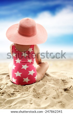 pink sun hat and child  - stock photo