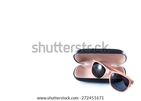 pink sunglasses in black opened case on white background  - stock photo