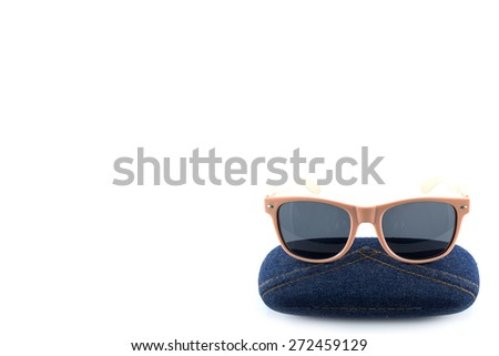 pink sunglasses in jean case on white background  - stock photo