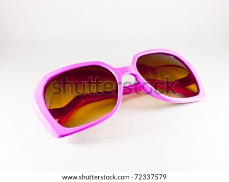 Pink sunglasses isolated on the white background - stock photo