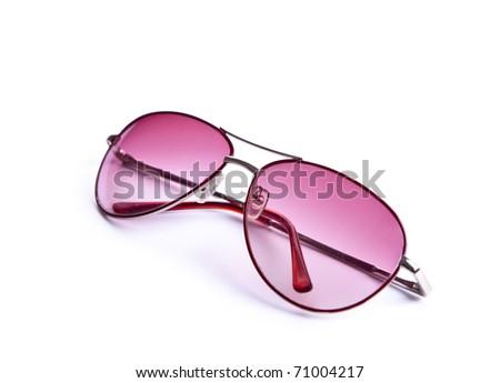Pink sunglasses on white - stock photo