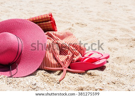 Pink Sunhat Flip Flops Bag Starfish Sand Beach Summer Holiday Concept - stock photo