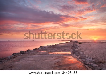 Pink sunset in the sea - stock photo