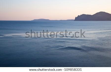 Pink sunset on black sea in Crimea - stock photo