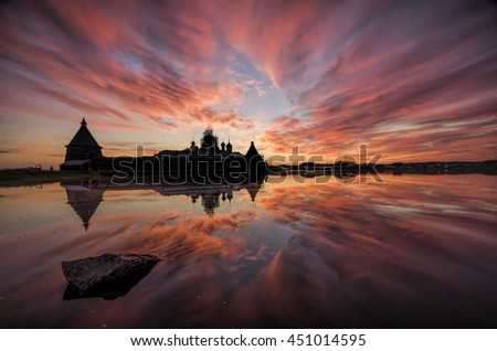 Pink sunset on the lake with a view of the Solovetsky Monastery. Russia, Arkhangelsk region, Solovki