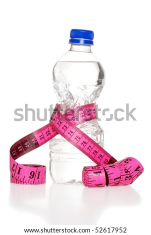 pink tape measure and water bottle - stock photo