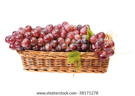 Pink,tasty grapes in the basket isolated on a white background. - stock photo