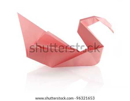 pink tender origami swam on the white reflecting background