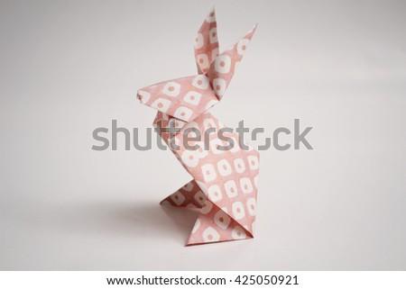 Pink textured rabbit origami - stock photo