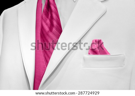 pink tie and vest with handkerchief in breast pocket accenting a white wedding tuxedo - stock photo