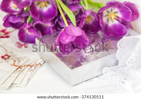 Pink tulip bouquet with silver bonbon box and lace to holiday card - stock photo